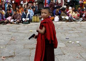 monk with toy gun